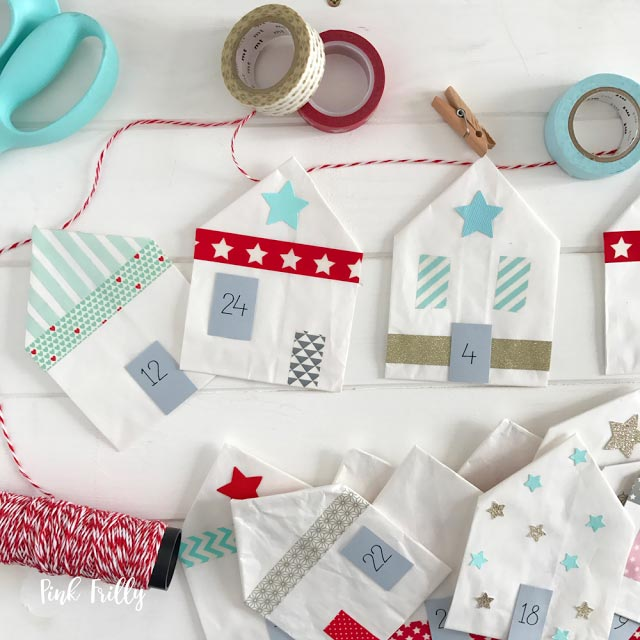 Advent Calendar - an awesome homemade Advent Calendar idea for kids. Easy to make from paper and washi tape you can put tiny fun treats and gifts in the paper houses as fillers or if you prefer small kindness activities for the whole family #adventcalender #christmas #christmasideas #christmascrafts #christmaskids #kindness